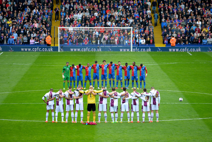 Players and fans observe a minute's silence to mark the 25th anniversary of the Hillsborough disaster prior to the Barclays Premier League match between Crystal Palace and Aston Villa at Selhurst Park in London, England. (Christopher Lee/Getty Images)
