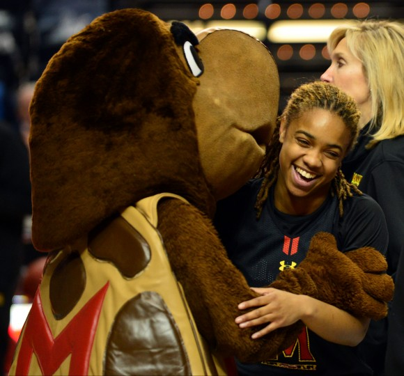 Maryland Terrapins mascot Testudo hugs guard Sequoia Austin during practice before the semifinals of the Final Four. The team will play Notre Dame and try to get to the 2014 NCAA Womens Division I Championship game at Bridgestone Arena in Nashville. (Don McPeak/USA Today Sports)