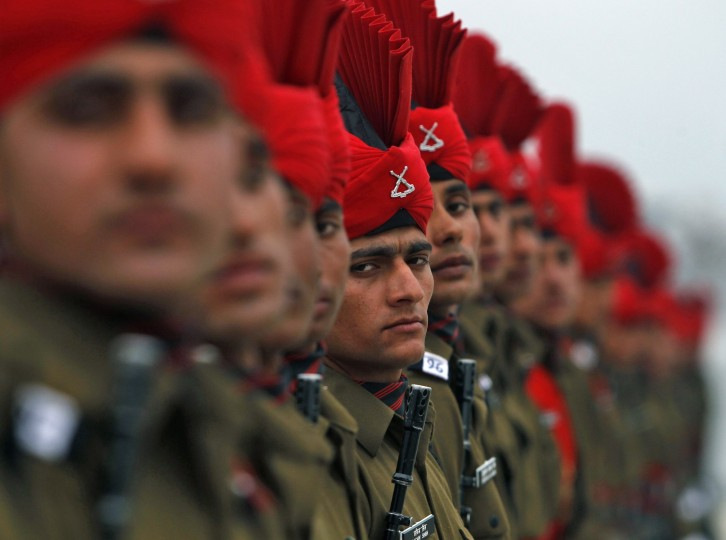 Indian army recruits take part in their passing out parade at a garrison in Rangreth on the outskirts of Srinagar. The 311 young Kashmiri men from various religious backgrounds were formally inducted into the Indian Army's Jammu and Kashmiri Light Infantry Regiment after 49 weeks of training. (Danish Ismail/Reuters)1