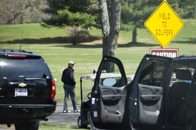 President Barack Obama walks from a sports utility vehicle upon arrival at the Andrews Air Force Base golf course in Maryland. Obama is at Andrews for a weekend game of golf. (Mandel Ngan/AFP/Getty Images)
