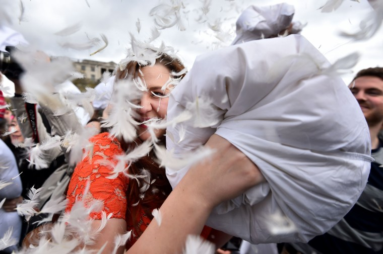 Revelers take part in a mass pillow fight in Trafalgar Square in central London on International Pillow Fight Day. ( Ben Stansall/AFP/Getty Images)