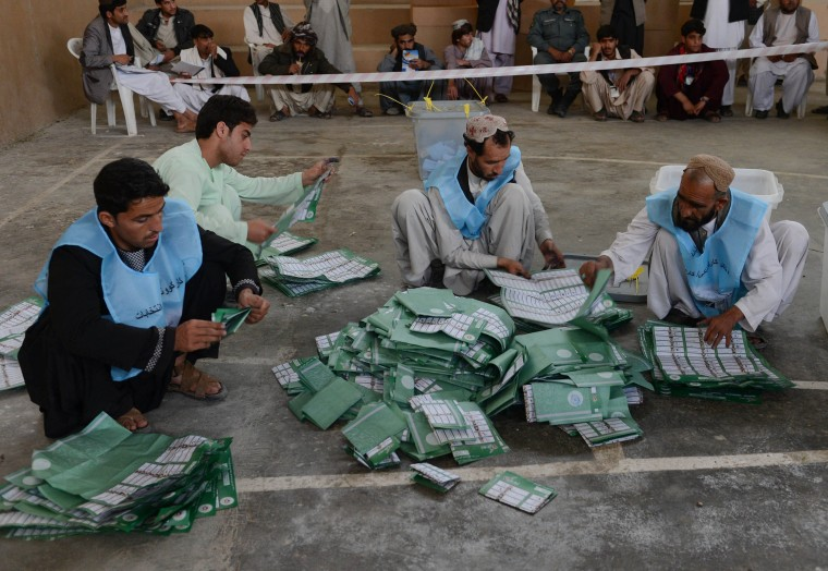 Afghan election officials count paper ballots at the end of polling in Kandahar. Afghans voted in large numbers to choose a successor to President Hamid Karzai in the country's first democratic transfer of power as U.S.-led forces end their 13-year involvement with the country. (Banaras Khan/AFP/Getty Images)