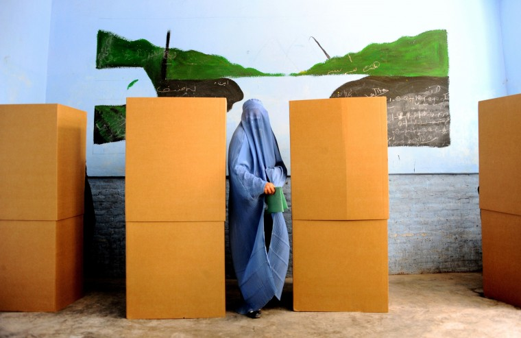 An Afghan woman after casting her vote at a polling station in the northwestern city of Herat. Afghan voters went to the polls to choose a successor to President Hamid Karzai, braving Taliban threats in a landmark election held as U.S. forces wind down their long intervention in the country. (Aref Karimi/AFP/Getty Images)