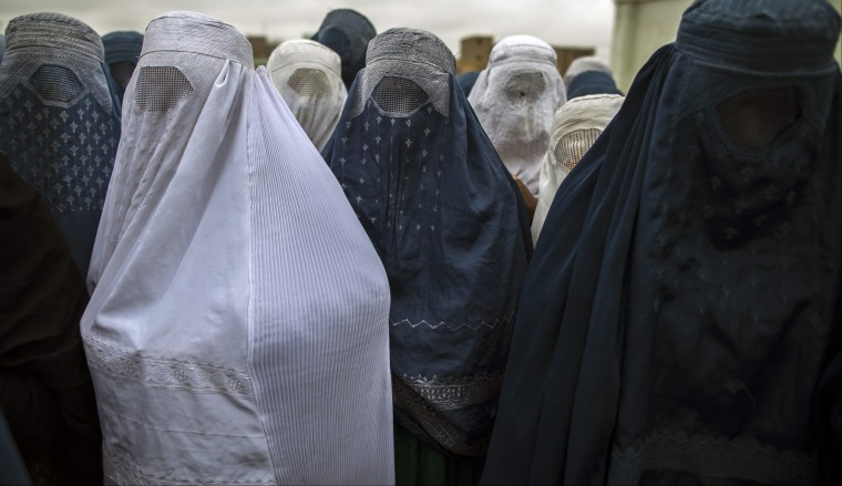 Afghan women wait to cast their ballot at a polling station in Mazar-i-sharif. Voting began on Saturday in Afghanistan's presidential election, which will mark the first democratic transfer of power since the country was tipped into chaos by the fall of the hardline Islamist Taliban regime in 2001. (Zohra Bensemra/Reuters)