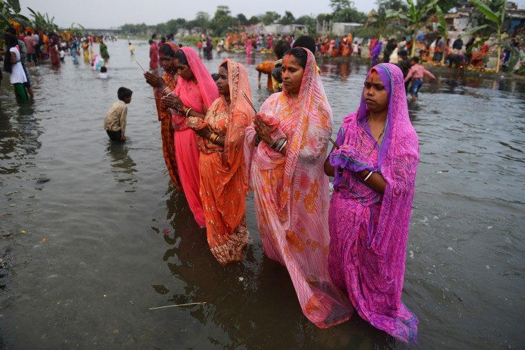 Indian Hindu devotees offer prayers during the Chaiti Chhath festival in Siliguri. Devotees pay obeisance to both the rising and the setting sun in the Chhath festival when people express their thanks and seek the blessings of the forces of nature, mainly the sun and river. (Dutta Diptendu/AFP/Getty Images)