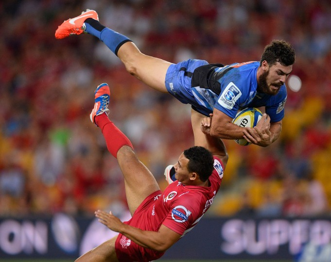 Jayden Hayward of the Force collides midair with Jonah Placid of the Reds during the round eight Super Rugby match at Suncorp Stadium in Brisbane, Australia. (Ian Hitchcock/Getty Images)