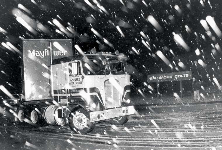 In March 1984 Mayflower moving vans carrying the Baltimore Colts' equipment left Baltimore for Indianapolis in the middle of the night. (Lloyd Pearson/Baltimore Sun)
