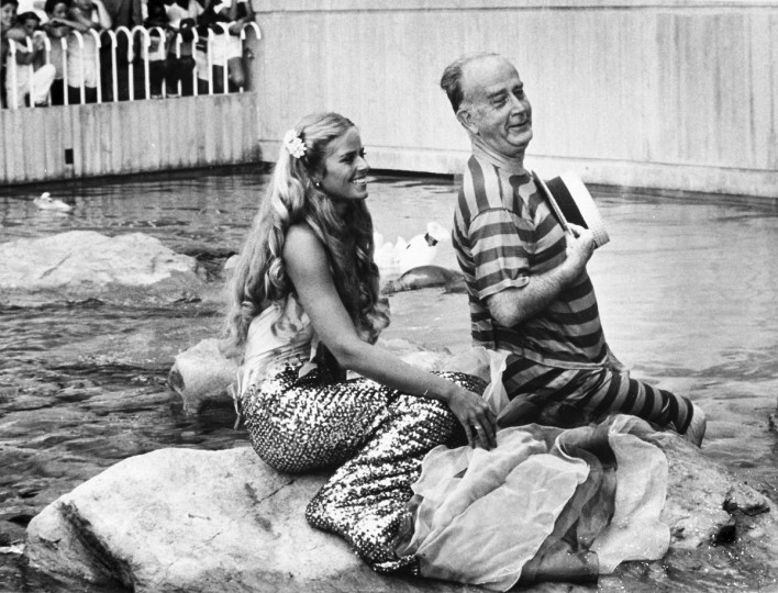 For a publicity stunt for the National Aquarium, due to open in a few weeks in July 1981, then-mayor William Donald Schaefer donned an old-fashioned swimsuit with a mermaid in the seal pool outside the facility. (Lloyd Pearson/Baltimore Sun)