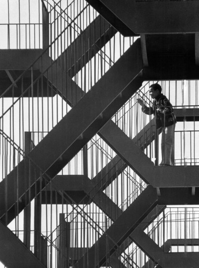 In April 1976, a youngster greets a friend amid the artistic pattern of stairs at a Callow Street project building. (Lloyd Pearson/Baltimore Sun)