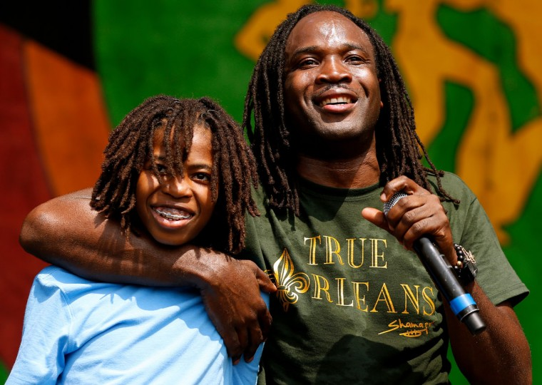 Shamarr Allen and his son perform during the first day of the New Orleans Jazz and Heritage Festival. (REUTERS/Jonathan Bachman)