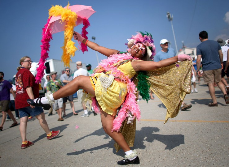Jennifer Jones of New Orleans parades during the first day of the New Orleans Jazz and Heritage Festival. (REUTERS/Jonathan Bachman)