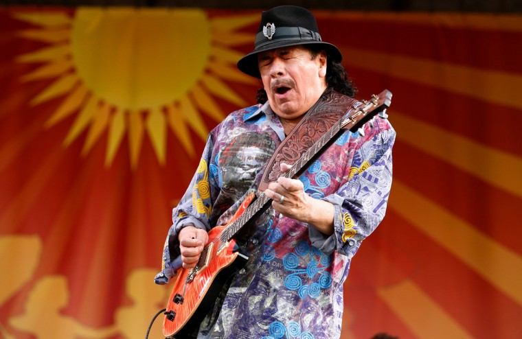 Carlos Santana performs during the first day of the New Orleans Jazz and Heritage Festival in New Orleans. (REUTERS/Jonathan Bachman)