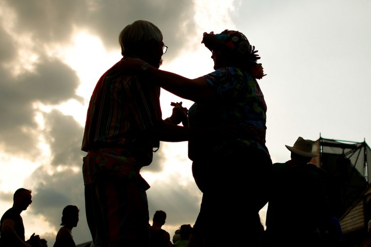 Festival goers dance during the first day of the New Orleans Jazz and Heritage Festival. (REUTERS/Jonathan Bachman)