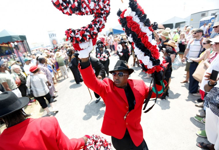 Members of the Big Nine Social Aid and Pleasure Club parade during the first day of the New Orleans Jazz and Heritage Festival. (REUTERS/Jonathan Bachman)