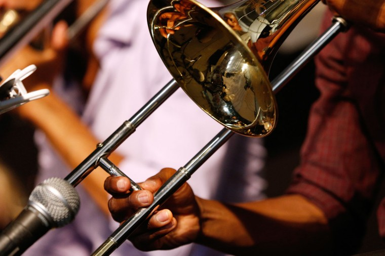A musician plays a trombone during the first day of the New Orleans Jazz and Heritage Festival. (REUTERS/Jonathan Bachman)
