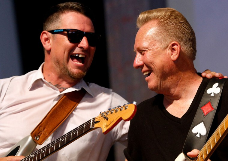 Eric Lindell, left, performs with Anson Funderburgh during the first day of the New Orleans Jazz and Heritage Festival. (REUTERS/Jonathan Bachman)