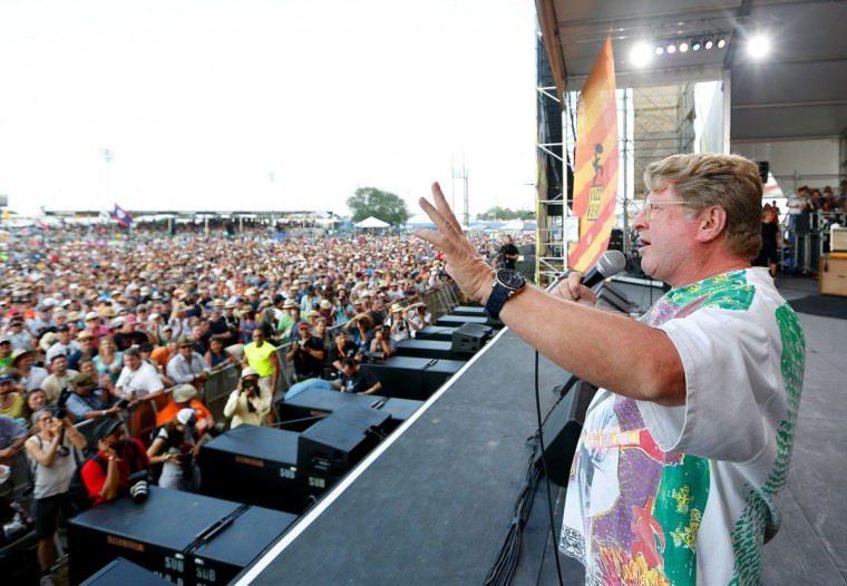 Festival producer Quint Davis introduces the main act during the first day of the New Orleans Jazz and Heritage Festival. (REUTERS/Jonathan Bachman)