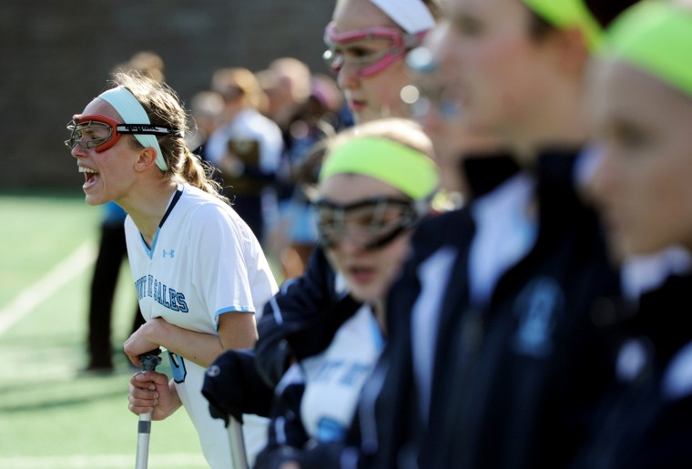 Mount de Sales' Allie Hynson, left, yells words of encouragement to hear teammates from the sidesline while she takes a rest during a lacrosse game at Mount de Sales Academy in Catonsville on Wednesday, April 9, 2014. (Jon Sham/BSMG)