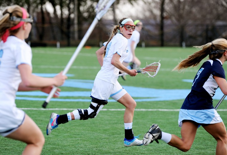 Mount de Sales' Allie Hynson, center, chases after Garrison Forest's Relly King, right, during a game at Mount de Sales Academy in Catonsville on Wednesday, April 9, 2014. (Jon Sham/BSMG)