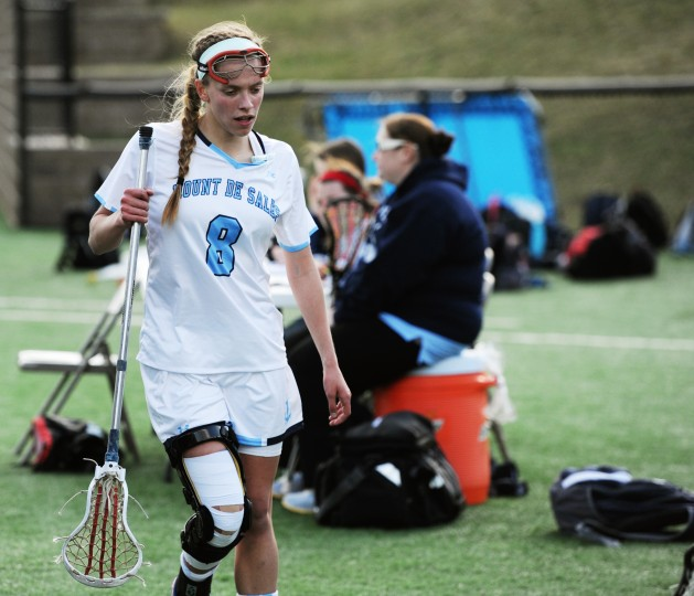 Mount de Sales' Allie Hynson walks off the field to take a breather during the fourth quarter of a game against Garrison Forest at Mount de Sales Academy in Catonsville on Wednesday, April, 9, 2014. (Jon Sham/BSMG)