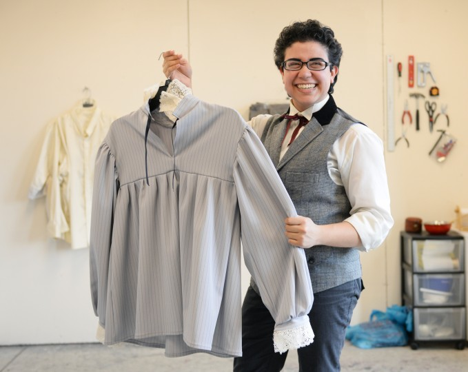 MICA student and Ellicott City native Amadeus Guchhait poses for a photo with one of his designed pieces of clothing at his studio in Baltimore on Friday, March 28, 2014. (Jon Sham/BSMG)