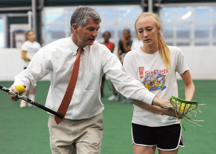Baltimore Lutheran School girls lacrosse coach John Tucker uses senior Lindsey Chamberlain to demonstrate a drill in practice arena beside the school in Towson on Thursday, April 3, 2014. (Jon Sham/BSMG)