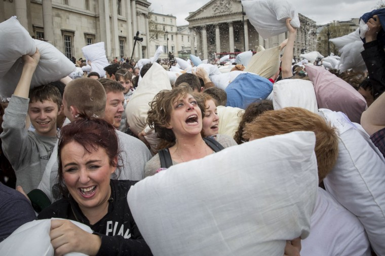Revellers take part in a giant pillow fight on the north terrace of Trafalgar Square on 'International Pillow Fight Day' on April 5, 2014 in London, England. Pillow fights have been organised numerous other cities around the world simultaneously. (Photo by Rob Stothard/Getty Images)