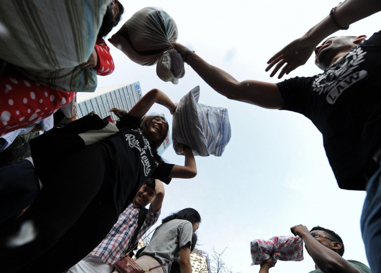 People hit each other with pillows during the fourth international pillow fight day in Hong Kong on April 5, 2014. Some two hundred people formed a sea of pillows and loose feathers as they went at each other while wearing a colourful assortment of pajamas. (Dale De La Rey/AFP/Getty Images)