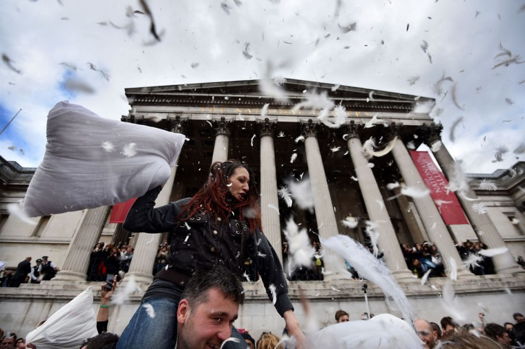 Revellers take part in a mass pillow fight in Trafalgar Square in central London on April 5, 2014 on International Pillow Fight Day. (Ben Stansall/AFP/Getty Images)