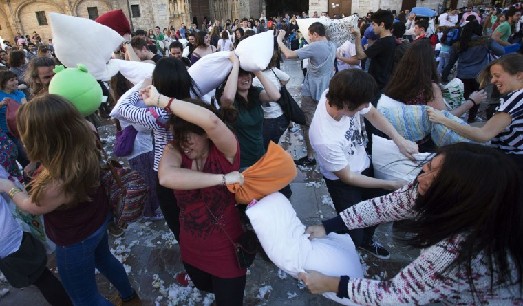 People hit each other with pillows during an event dubbed International Pillow Fight Day in Valencia on April 5, 2014. The event, which was created in 2008, claims worldwide participation of over 80 cities for the 2014 edition. (Jose Jordan/AFP/Getty Images)