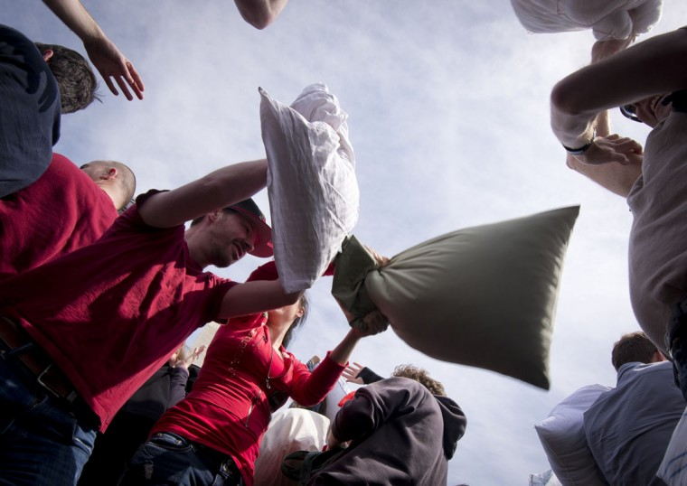 People hit each other with pillows during an event dubbed International Pillow Fight Day next to the Washington Monument in Washington on April 5, 2014. The event, which was created in 2008, claims worldwide participation of over 80 cities for the 2014 edition. (Mdaden Antonov/AFP/Getty Images)