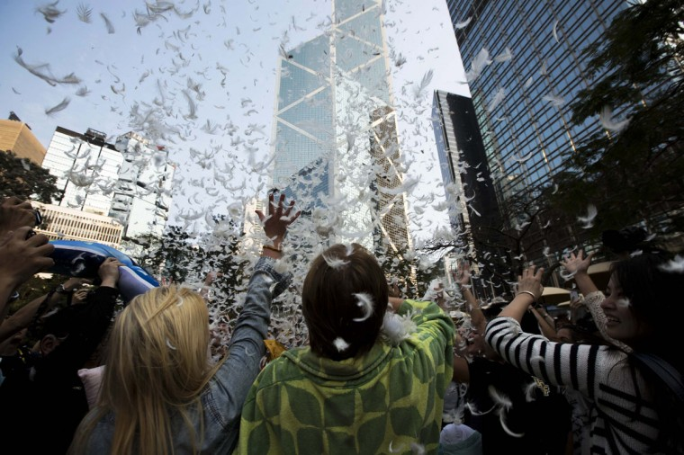 People take part in the International Pillow Fight Day at Hong Kong's financial Central district April 5, 2014. (REUTERS/Tyrone Siu)
