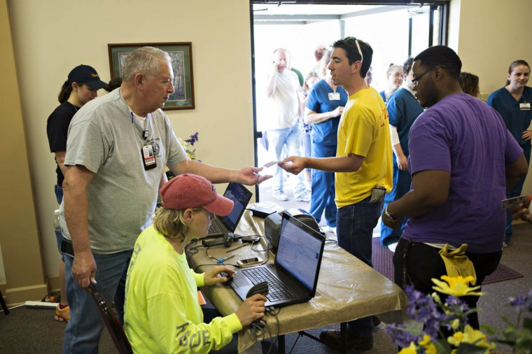 Ken Brown hands out IDs at Beryl Baptist Church to volunteers after a tornado yesterday tore through the area for the second time in three years, on April 28, 2014 in Vilonia, Arkansas. After deadly tornadoes ripped through the region, leaving more than a dozen dead, Mississippi, Arkansas, Texas, Louisiana and Tennessee are all under watch as multiple storms over the next few days are expected. (Wesley Hitt/Getty Images)