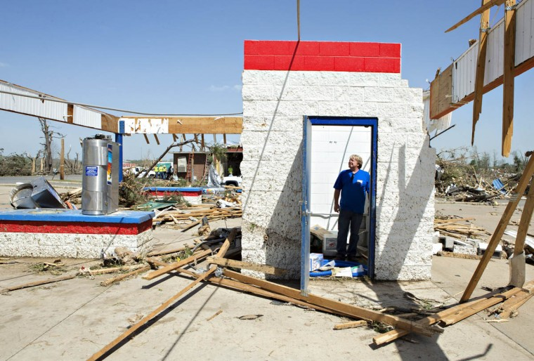 Ken Sullivan, general manager of We Willies Super Auto Wash, looks over the damage after a tornado yesterday tore through the area for the second time in three years, on April 28, 2014 in Vilonia, Arkansas. After deadly tornadoes ripped through the region, leaving more than a dozen dead, Mississippi, Arkansas, Texas, Louisiana and Tennessee are all under watch as multiple storms over the next few days are expected. (Wesley Hitt/Getty Images)