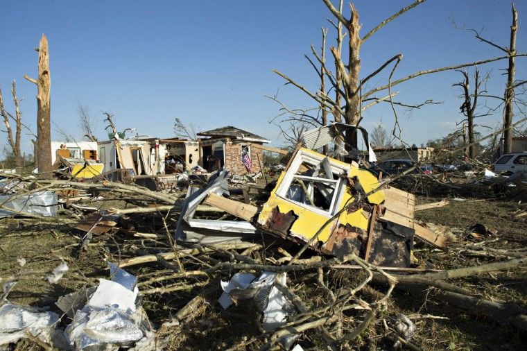 Debris from a house destroyed by a tornado yesterday that tore through the area for the second time in three years is shown, on April 28, 2014 in Mayflower, Arkansas. After deadly tornadoes ripped through the region leaving more than a dozen dead, Mississippi, Arkansas, Texas, Louisiana and Tennessee are all under watch as multiple storms over the next few days are expected. (Wesley Hitt/Getty Images)