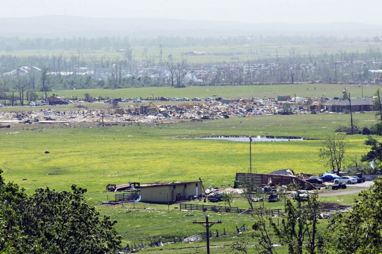 An elevated view shows damage along the path of a tornado that yesterday tore through the area for the second time in three years, on April 28, 2014 in Vilonia, Arkansas. After deadly tornadoes ripped through the region, leaving more than a dozen dead, Mississippi, Arkansas, Texas, Louisiana and Tennessee are all under watch as multiple storms over the next few days are expected. (Wesley Hitt/Getty Images)