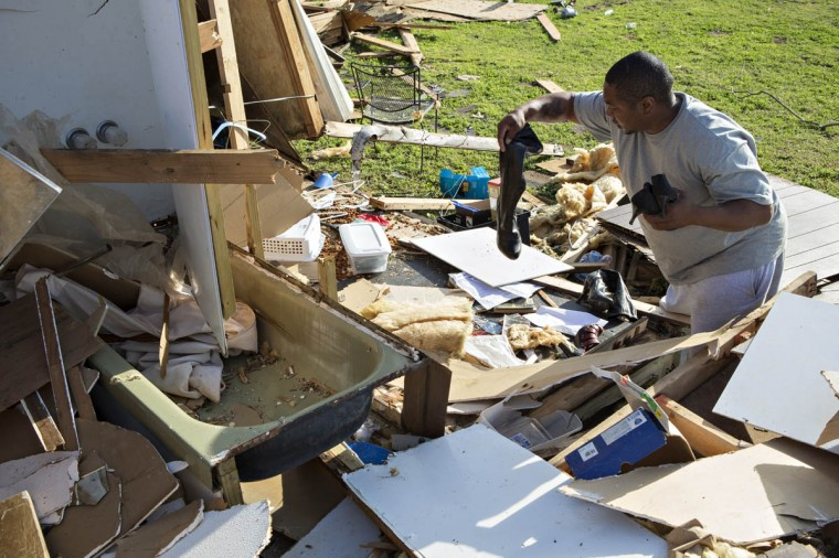 James Guiden looks through what is left of his house after a tornado yesterday tore through the area for the second time in three years, on April 28, 2014 in Mayflower, Arkansas. Guiden and his wife survived by taking shelter in the green bath tub in front of him. After deadly tornadoes ripped through the region leaving more than a dozen dead, Mississippi, Arkansas, Texas, Louisiana and Tennessee are all under watch as multiple storms over the next few days are expected. (Wesley Hitt/Getty Images)
