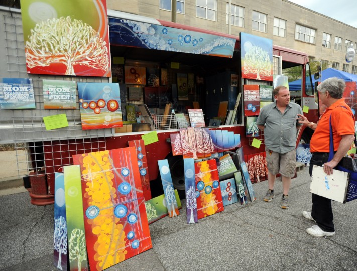 Local artist Shawn Theron of Carney talks about his art truck with Mort Baron of Annapolis, right, during the Towsontown Spring Festival on Saturday, May 3. (Brian Krista/BSMG)