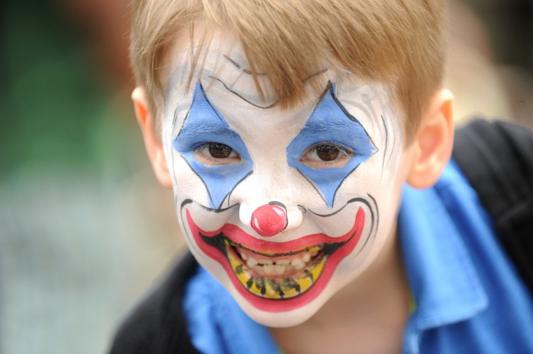 Alexander Newsome, 6, of Lutherville is seen with his face painted like a clown during the Towsontown Spring Festival on Saturday, May 3. (Brian Krista/BSMG)