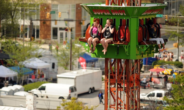 Thrill seekers react as a carnival ride begins to drop during the Towsontown Spring Festival on Saturday, May 3. (Brian Krista/BSMG)