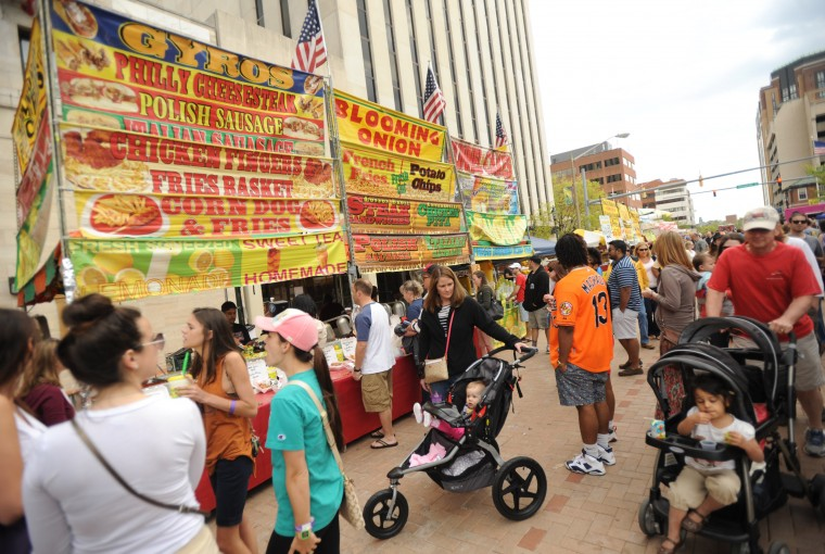 Festival-goers line up for a meal from food vendors on Washington Avenue in downtown Towson during the Towsontown Spring Festival on Saturday, May 3. (Brian Krista/BSMG)