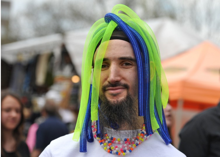 """Jethro Polak of Pikesville wears a """"cyberlox"""" cap he created at the annual Towsontown Spring Festival. (Amy Davis/Baltimore Sun Staff)"""