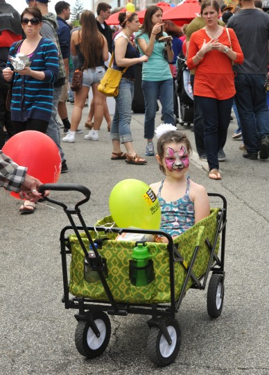 Blythe Bradford, 6, of Towson, gets a ride through the crowds at the annual Towsontown Spring Festival. (Amy Davis/Baltimore Sun Staff)
