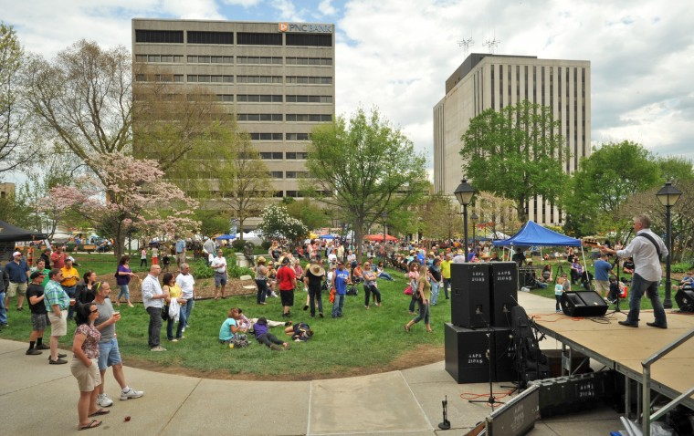 Festival-goers gather in the park in front of the old Towson Courthouse to listen to Rob Fahey and the Pieces at the annual Towsontown Spring Festival. On stage at right is guitarist Jeff Wolinski. (Amy Davis/Baltimore Sun Staff)