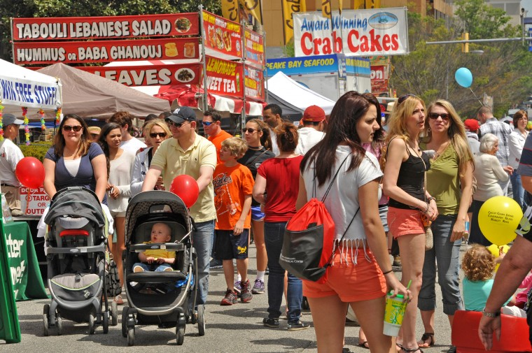 Festival-goers stroll along W. Pennsylvania Avenue at the annual Towsontown Spring Festival, which benefitted from great weather. (Amy Davis/Baltimore Sun staff)