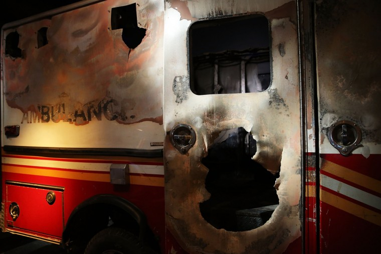 A destroyed fire department ambulance from Ground Zero is viewed during a preview of the National September 11 Memorial Museum on May 14, 2014 in New York City. (Spencer Platt/Getty Images)