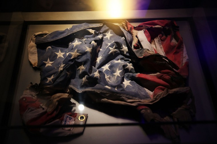 An American Flag recovered from the World Trade Center site is viewed during a preview of the National September 11 Memorial Museum. (Spencer Platt/Getty Images)