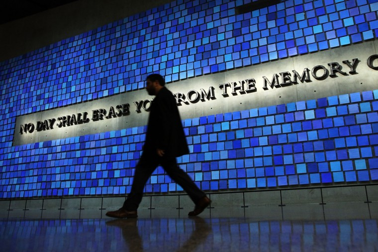 A wall with a quote from Virgil and featuring 2,983 panels for each victim is viewed during a tour of the National September 11 Memorial Museum. (Spencer Platt/Getty Images)