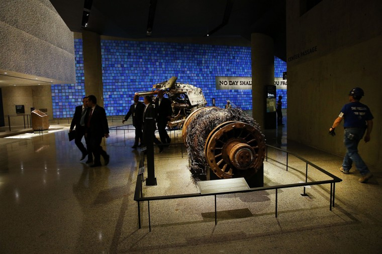 Artifacts from Ground Zero, including an elevator motor from one of the buildings, is viewed during a preview of the National September 11 Memorial Museum. (Spencer Platt/Getty Images)