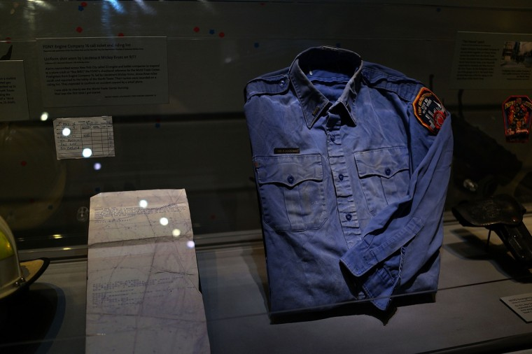 A firefighters shirt used at Ground Zero on September 11 is viewed during a tour the National September 11 Memorial Museum on May 14, 2014 in New York City. (Spencer Platt/Getty Images)